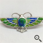 Scarab brooche before and after